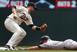 July 19, 2017 - Minneapolis, MN, USA - Minnesota Twins second baseman Brian Dozier, left, tags out the New York Yankees' Brett Gardner at second base while trying to steal at Target Field in Minneapolis on Wednesday, July 19, 2017. The Twins won, 6-1. (Credit Image: © Richard Tsong-Taatarii/TNS via ZUMA Wire)