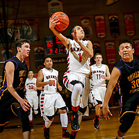 010914  Adron Gardner/Independent<br /> <br /> Grants Pirate Orlando Ware (1) attempts a layup on the Kirtland Central Broncos during the Gallup Invitational boys basketball tournament in Gallup Thursday.