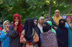 May 28, 2017 - Srinagar, India - Women wail over the killing of Hizbul Mujahideen rebel Sabzaar in Tral area of Kashmir. Sabzaar was killed in a fierce encounter with Indian forces on Saturday. Whole Kashmir valley reels under strict curfew, mobile serives and internet is banned. (Credit Image: © Muzamil Mattoo/Pacific Press via ZUMA Wire)