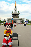 Mickey Mouse sitting in front of the entrance to the All Russia Exhibition Center in Moscow.