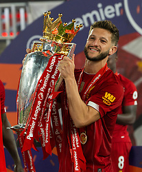 LIVERPOOL, ENGLAND - Wednesday, July 22, 2020: Liverpool's Adam Lallana celebrates with the Premier League trophy as the Reds are crowned Champions after the FA Premier League match between Liverpool FC and Chelsea FC at Anfield. The game was played behind closed doors due to the UK government's social distancing laws during the Coronavirus COVID-19 Pandemic. (Pic by David Rawcliffe/Propaganda)