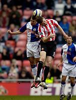 Photo: Jed Wee.<br />Sunderland v Blackburn Rovers. The Barclays Premiership. 25/03/2006.<br /><br />Blackburn's David Bentley (L) jumps with Sunderland's Kevin Kyle.