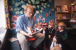 Nursery school teacher reading to pupils,