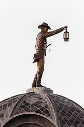 The Nightwatchman sculpture on top of City Hall, honoring men who protected town in early 1900s, Grapevine, Texas USA
