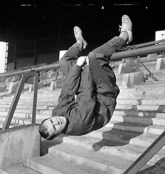 Ray Wilson, Huddersfield Town left back, exercising on a  crush barrier at Leeds Road.