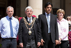 © Licensed to London News Pictures. 03_07_2015. Birmingham, West Midlands, UK. The scene at noon in Birmingham today as the minute silence took place to honour the lives lost in the Tunisia bombings. Lord Mayor Ray Hassall, leads the tributes outside the Council House in Victoria Square. Photo credit : Dave Warren/LNP
