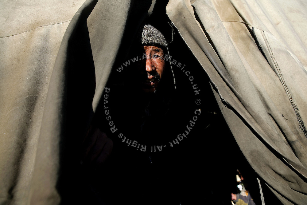 A labourer in his tent during an early morning on the Leh-Manali Highway.
