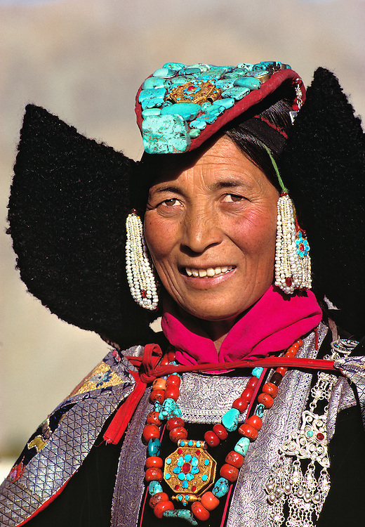 A Ladakhi Woman shows off her beautiful coral and turquoise jewelery and perak headdress in Leh, Ladakh, India.