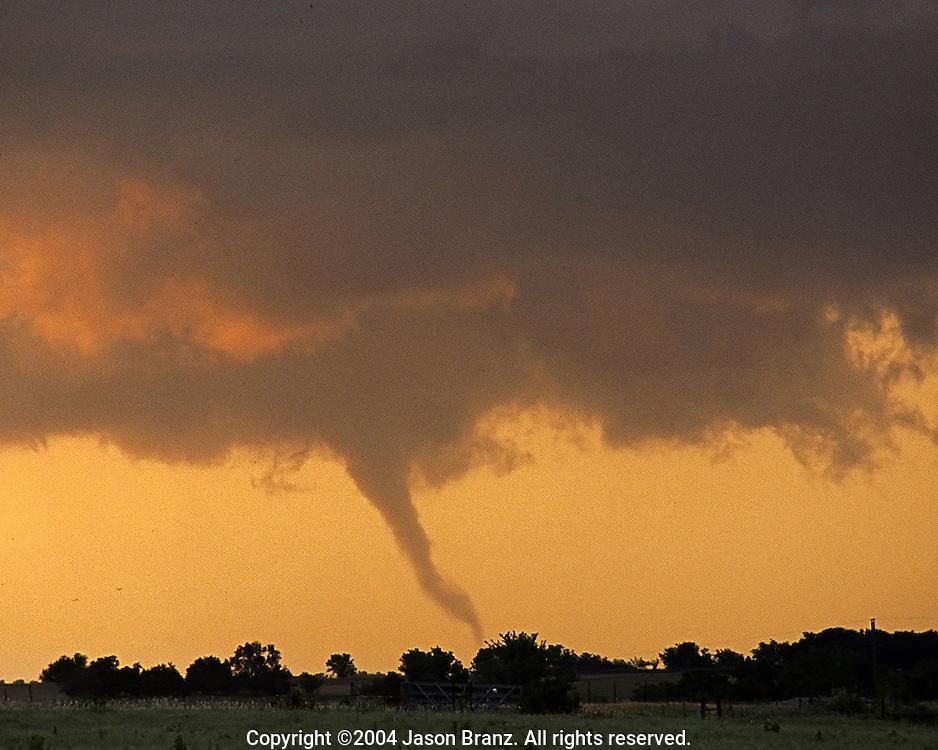 Weak tornado at sunset in southern Kansas.