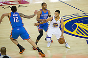 Golden State Warriors guard Stephen Curry (30) dribbles past the Oklahoma City Thunder defense at Oracle Arena in Oakland, Calif., on November 3, 2016. (Stan Olszewski/Special to S.F. Examiner)