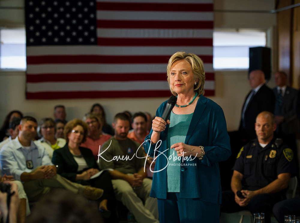 Hillary Clinton listens to comments from the crowd during the Community Forum on substance abuse held at the Laconia Boys and Girls Club on Thursday afternoon.  (Karen Bobotas/for the Laconia Daily Sun)