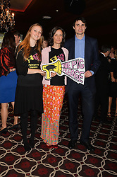 Left to right, LADY BELLA SOMERSET, her mother the MARCHIONESS OF WORCESTER and the EARL OF GLAMORGAN at the Pig Pledge Evening at Club no41, 41 Conduit Street, London on 10th March 2014.