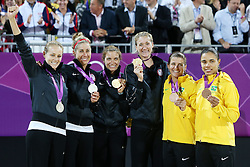 Olympics - London 2012 Olympic Games - Beach Volleyball - Women's Beach Volleyball Final - 8/8/12.General view as USA's Kerri Walsh Jennings (C) and Misty May Treanor celebrate display their gold medals during the medal ceremony with silver medallists USA's Jennifer Kessy and April Ross (L) and Bronze Medallists Brazil's Larissa Franca and Juliana Silva (R).© pixathlon
