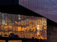Sunset reflecting color in the glass windows of the Harpa Building in downtown Reykjavik, Iceland