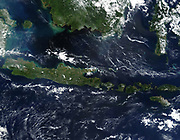 True-colour satellite image of Indonesia mid-May 2002. As burning season was not fully underway in the region,  skies over the island of Borneo, Malaysia at its northwest coast, are comparatively clear. Credit NASA.