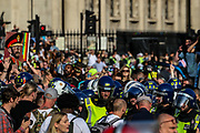 "Police clashed and arrested protestors during a ""Resist and Act for Freedom"" protest against a mandatory coronavirus vaccine, wearing masks, social distancing and a second lockdown, nearby Canada House in Trafalgar Square, London on Saturday, Sept. 19, 2020. The event, which began at noon, drew a broad coalition including coronavirus sceptics, 5G conspiracy theorists and so-called ""anti-vaxxers"". Speakers at the event accused the government of attempting to curtail civil liberties. (VXP Photo/ Vudi Xhymshiti)"