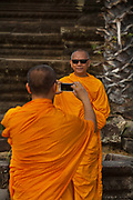 Buddhist monks visiting Angkor Wat.<br /> Angkor is one of the most important archaeological sites in South-East Asia. Stretching over some 400 km2, including forested area, Angkor Archaeological Park contains the magnificent remains of the different capitals of the Khmer Empire, from the 9th to the 15th century. They include the famous Temple of Angkor Wat and, at Angkor Thom.  UNESCO has set up a wide-ranging programme to safeguard this symbolic site and its surroundings
