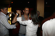 Frederick's Lounge. New York, New York.  Unites States..October 14th 2006..Red Bulls French soccer player Youri Djorkaeff dances with his wife Sophie during a party with familly and friends after a game against Kansas City at the Giants Stadium.This game could have been his last one as a professional player if the Red Bulls didn't win 3-2.