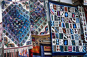 Colorful rugs are sold in Urubamba (Vilcanota) River Valley, Peru, South America.