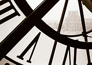 Close up of clock in Musee d'Orsay cafeteria, Paris, France with Louvre museum across the Seine