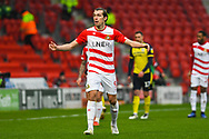 John Marquis of Doncaster Rovers (9) looks towards the assistant referee in shock during the EFL Sky Bet League 1 match between Doncaster Rovers and Scunthorpe United at the Keepmoat Stadium, Doncaster, England on 15 December 2018.