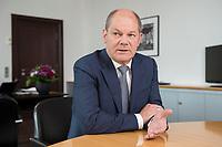 25 JUN 2018, BERLIN/GERMANY:<br /> Olaf Scholz, SPD, Bundesfinanzminister, waehrend einem Interview, in seinem Buero, Bundesministerium der Finanzen<br /> IMAGE: 20180625-02-015<br /> KEYWORDS: Büro