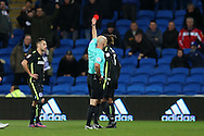 Gaetan Bong of Brighton & Hove Albion is sent off by referee Roger East after getting a 2nd yellow and red card. EFL Skybet championship match, Cardiff city v Brighton & Hove Albion at the Cardiff city stadium in Cardiff, South Wales on Saturday 3rd December 2016.<br /> pic by Andrew Orchard, Andrew Orchard sports photography.