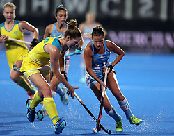 Argentina's Delfina Merino and Australia's Georgina Morgan in action
