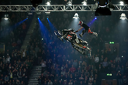 © licensed to London News Pictures. London, UK 14/03/2012. A professional snowmobile rider is performing a stunt in the air as Masters of Dirt show takes place in Wembley Arena in London. Photo credit: Tolga Akmen/LNP