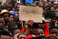 DURBAN - 17 October 2016 - A protester of the FeesMustFall makes his point at a protest outside the Durban City Hall where students from the University of KwaZulu-Natal and the Durban University handed over a memorandum.  South Africa's tertiary institutions have been gripped by ongoing violent protests against university fees and a host of other complaints. Picture: Allied Picture Press/APP