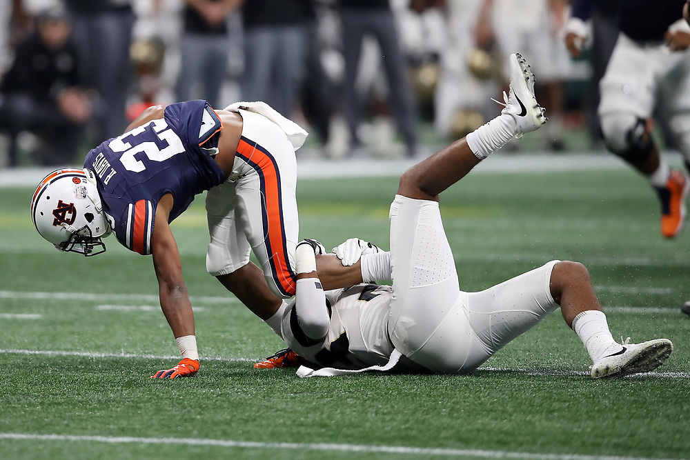Auburn Tigers wide receiver Ryan Davis (23) runs the ball away from UCF Knights defensive back Brandon Moore (20) during the 2018 Chick-fil-A Peach Bowl NCAA football game on Monday, January 1, 2018 in Atlanta. (Jason Parkhurst / Abell Images for the Chick-fil-A Peach Bowl)