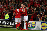Gareth Bale of Wales ® celebrates with teammates Joe Allen and Sam Vokes after he scores his teams 3rd goal. Wales v Moldova , FIFA World Cup qualifier at the Cardiff city Stadium in Cardiff on Monday 5th Sept 2016. pic by Andrew Orchard,