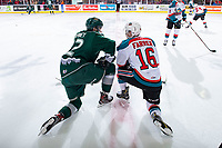 KELOWNA, CANADA - FEBRUARY 15: Justyn Gurney #22 of the Everett Silvertips catches up with Michael Farren #16 of the Kelowna Rockets while stretching on the ice during warm up  on February 15, 2019 at Prospera Place in Kelowna, British Columbia, Canada.  (Photo by Marissa Baecker/Shoot the Breeze)