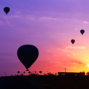 Hot air balloons silhouette in Goreme viewpoint at sunrise, Cappadocia, Turkey