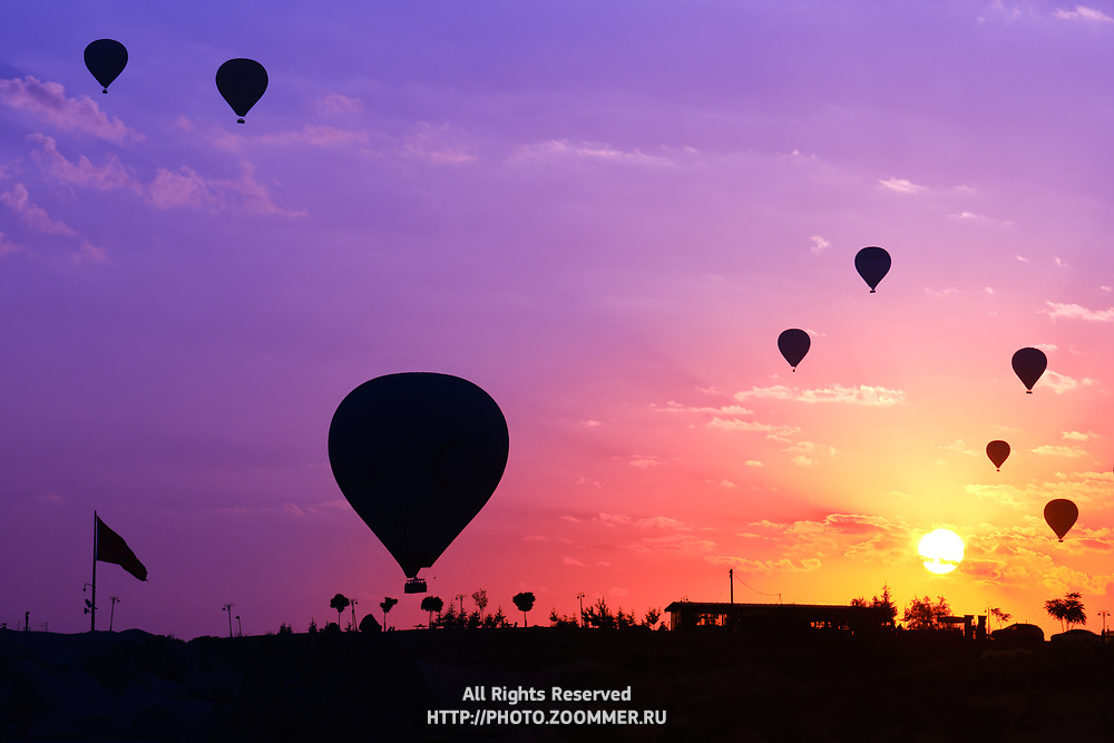 Hot air balloons silhouette in Goreme viewpoint at sunrise, Cappadocia, Turkey