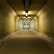 A spectacular vanishing point is created in this concrete tunnel under I-395 leading to the Pentagon parking area for the 9/11 Memorial outside Washington, DC
