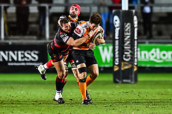 Cheetahs' William Small-Smith is tackled by Dragons' Elliot Dee<br /> <br /> Photographer Craig Thomas/Replay Images<br /> <br /> Guinness PRO14 Round 18 - Dragons v Cheetahs - Friday 23rd March 2018 - Rodney Parade - Newport<br /> <br /> World Copyright © Replay Images . All rights reserved. info@replayimages.co.uk - http://replayimages.co.uk