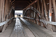 A Burr Arch Truss supports Crooks Covered Bridge (132 feet long), which was built in 1856 by Henry Wolfe over Little Raccoon Creek, on Wimmer Road, Parke County, Indiana, USA.