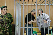 Moscow, Russia, 12/07/2004..Former Yukos CEO Mikhail Khodorkovsky [left] and business associate Platon Lebedev in court where they face charges of fraud, embezzlement and tax evasion.