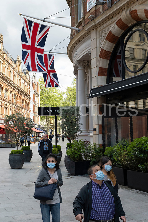People return to Leicester Square, one of Londons tourist hotspots on 26th May 2021 in London, United Kingdom. As the coronavirus lockdown continues its process of easing restrictions, more and more people are coming to the West End as more businesses open.