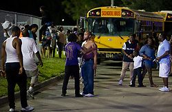 August 18, 2018 - Wellington, Florida, U.S. - Football fans react to a shooting during the fourth quarter of a game between William T. Dwyer and Palm Beach Central High School. Two adults were shot. The gunfire sent players and fans screaming and stampeding in panic at Palm Beach Central High School in Wellington, Florida on August 17, 2018. (Credit Image: © Allen Eyestone/The Palm Beach Post via ZUMA Wire)