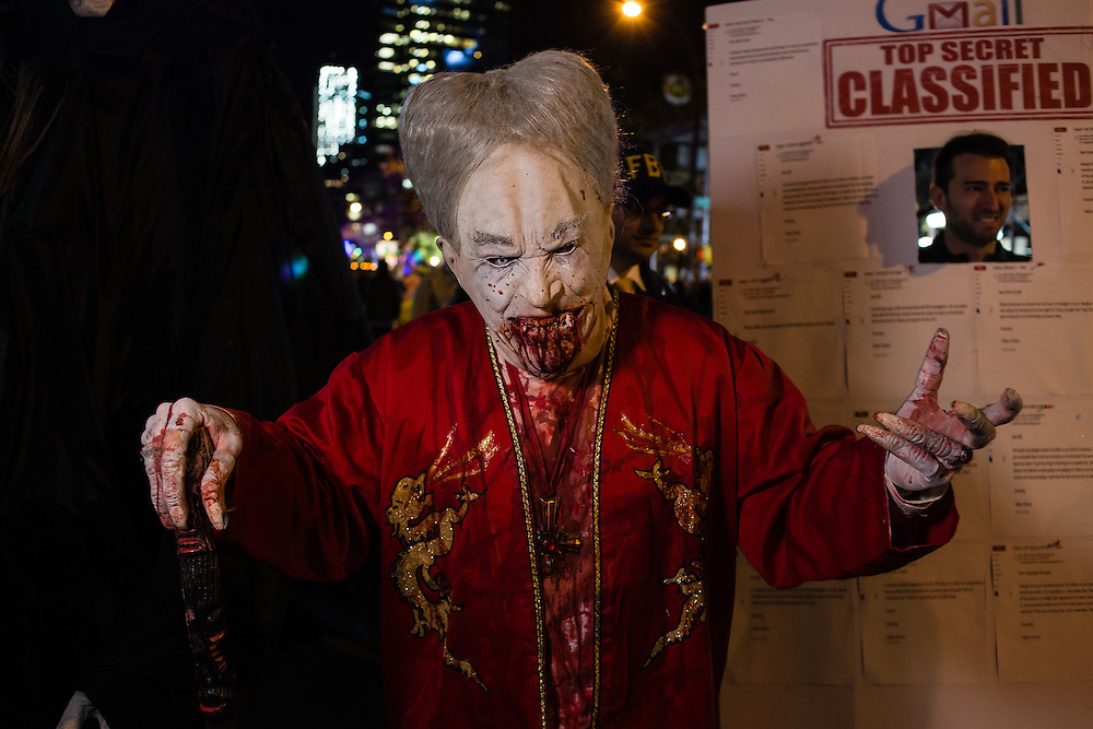 New York, NY - 31 October 2016. A man costuimed as an Asian zombie in the Greenwich Village Halloween Parade.