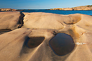 Glacially eroded Precambrian shield rock on coast islands in Georgian Bay (Lake Huron) near south end of Killarney Provincial Park. <br />South Philip Edward Island.<br />Ontario<br />Canada