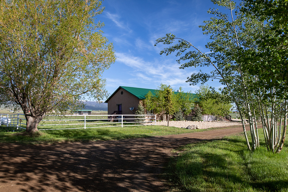 The guest house at A Painted View Ranch is set between horse paddocks and the gorgeous Sangre de Cristo Range.