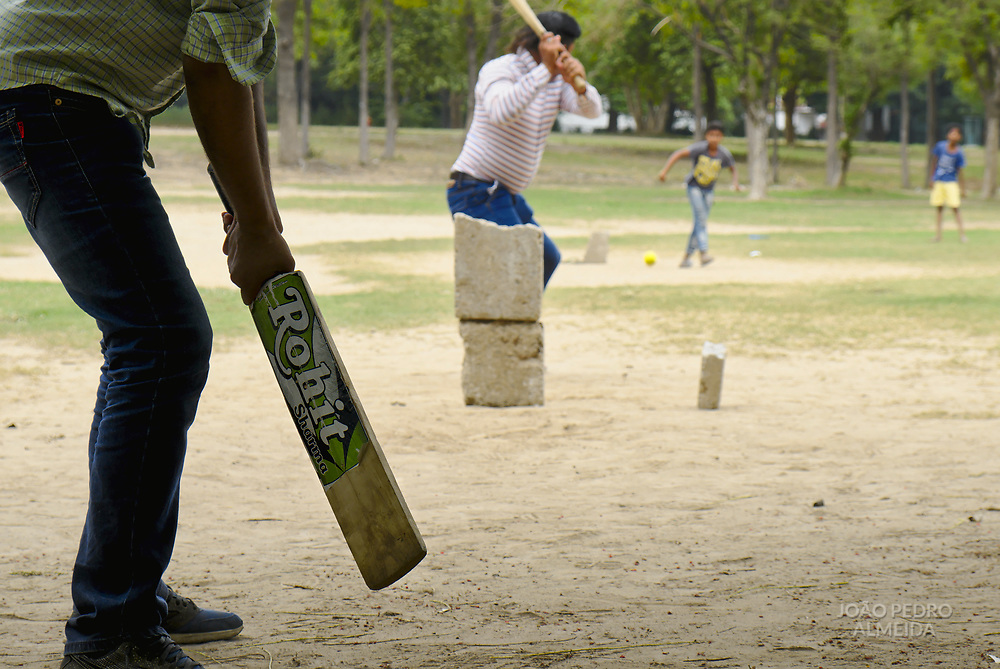 Playing cricket at one of Chandigarh's gardens