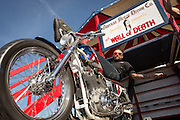 A motorcycle stunt performer rests on his Harley-Davidson bike in front of the Wall of Death sideshow during the 74th Annual Daytona Bike Week March 8, 2015 in Daytona Beach, Florida.