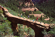 Global Fitness Adventures Health Spa clients do stretches on a sandstone arch, Sedona, Arizona..