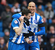 Brighton player Jamie Murphy celebrates his goal with Brighton striker Bobby Zamora during the Sky Bet Championship match between Brighton and Hove Albion and Bolton Wanderers at the American Express Community Stadium, Brighton and Hove, England on 13 February 2016. Photo by Bennett Dean.
