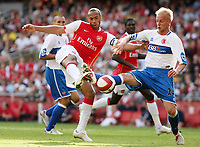 Photo: Chris Ratcliffe.<br />Arsenal v Middlesbrough. The Barclays Premiership. 09/09/2006.<br />Thierry Henry gets a shot in despite the attentions of Andrew Davies of Middlesbrough.