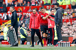 Manchester United's Ander Herrera (third right) shakes hands with Liverpool manager Jurgen Klopp after coming off injured during the Premier League match at Old Trafford, Manchester.
